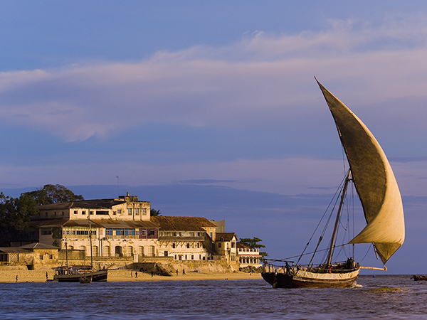 Dhow Under Sail in the Harbor